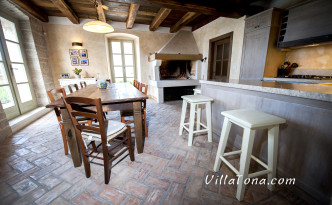 The Tavern with kitchen, big table and Fireplace